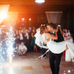 Happy bride and groom a their first dance, wedding in the elegant restaurant with a wonderful light and atmosphere