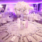 Indoor round reception table with flowers and chairs